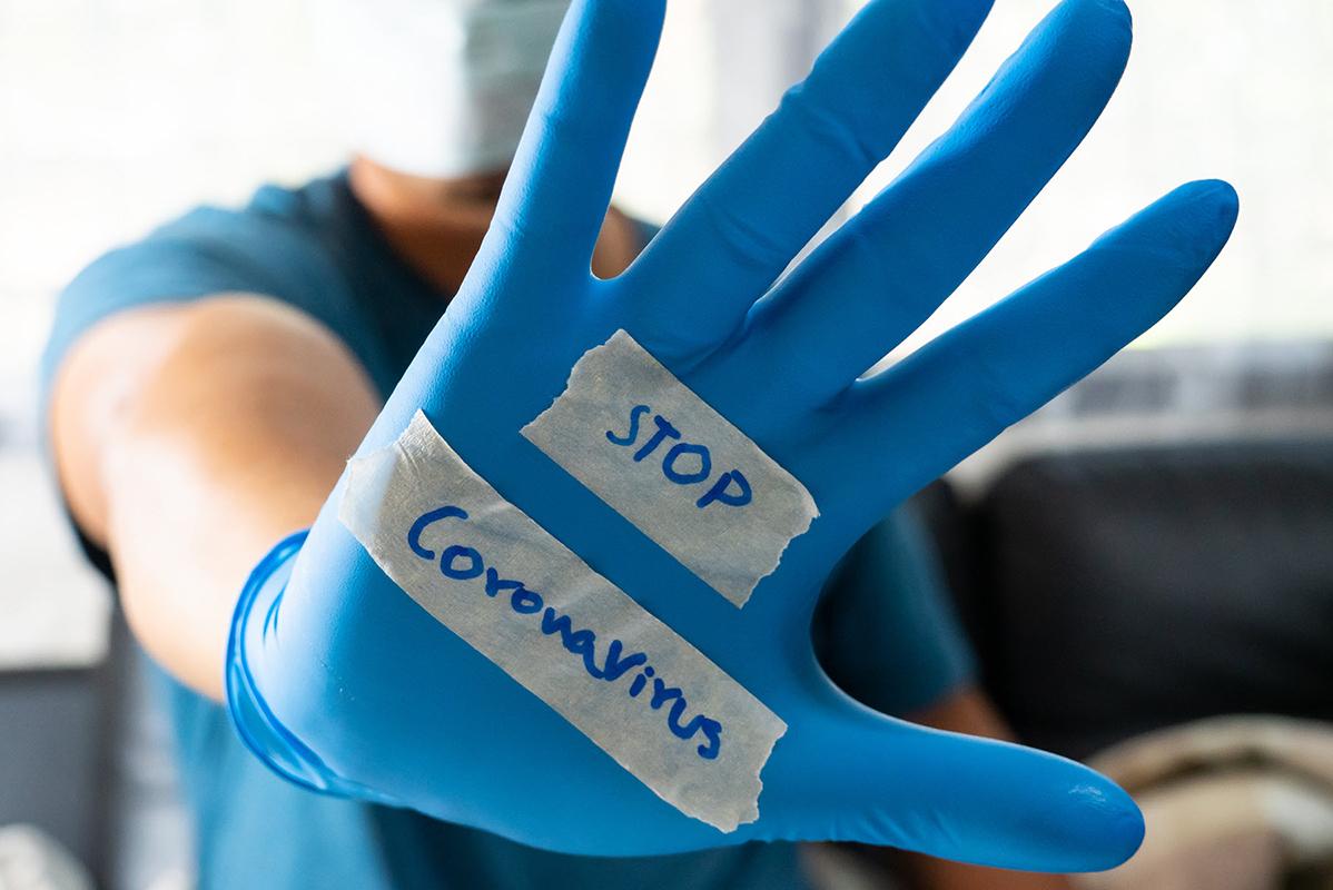 1800x1200_stop-coronavirus-doctors-hand.jpg